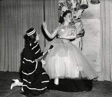 Two students on stage in costume