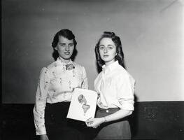 Students of first graduating class Anne Rosenbaum and Ruth Solomon with drawing of SCW class ring