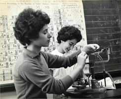 Two students in laboratory working with scale