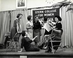 Students on stage rehearsing a performance