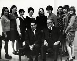 Group of students posing with Dean David Mirsky and unidentified man