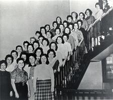 Sophomores of Class of 1961 posing on stairs