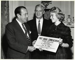 Student presenting oversized ticket to first SCW commencement to New York City Mayor Robert Wagner.  Max Stern also pictured.