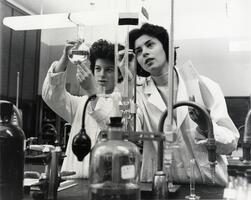 Two students in chemistry lab