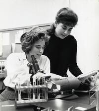 Two students using microscope