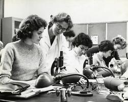 Students with Professor of Biology Phyllis Cahn in lab
