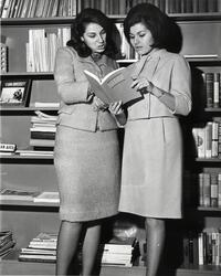 Two students examining SCW catalog