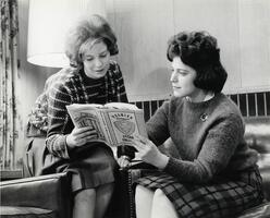 Two students in lounge reading
