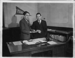Dean of Yeshiva College Shelley Saphire and unknown man in office
